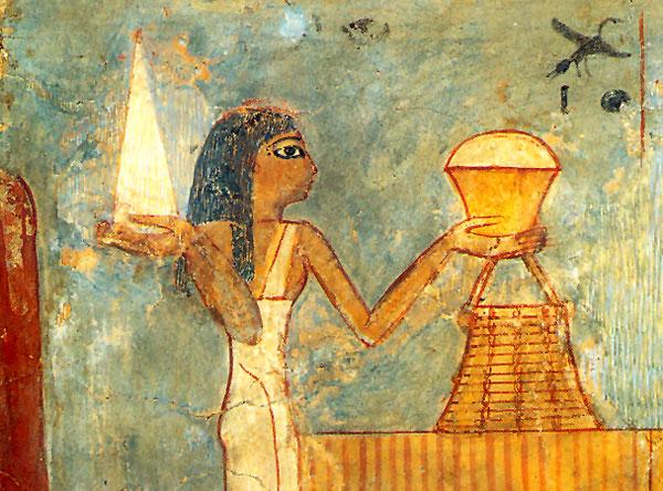 Fig. 10. Detalle de una pintura de la tumba de Unsu, procedente de Tebas Oeste, donde se puede ver a una muchacha llevando un pan blanco con forma cónica (Paris, Musée du Louvre, N 1431).