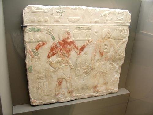 Bajo relieve de ofrendas funerarias